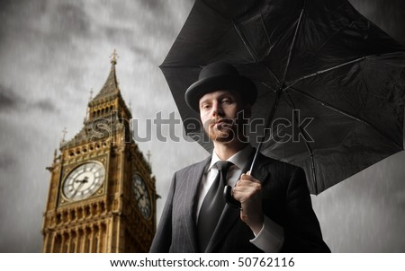 Gentleman with Big Ben on the background - stock photo