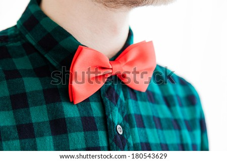 Gentleman with closeup fashioned red bowtie and green shirt - stock photo