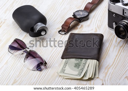 gentlemanly set:  sunglasses, perfume, wallet,camera, watch on wooden background