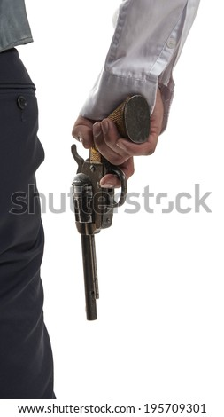 Gentlemen in a jacket holding gun in his hand.View from the back - stock photo