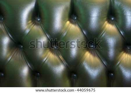 Gentlemen's club for wealthy men, leather Chesterfield sofa back. - stock photo
