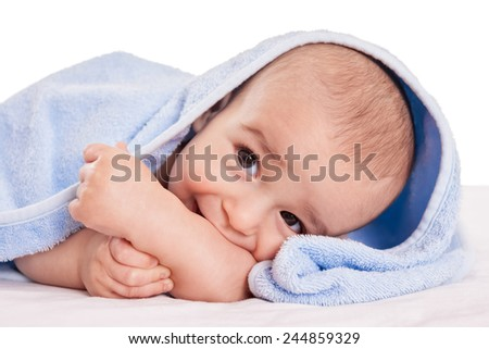 Gently beautiful baby enjoy in bed after bath isolated - stock photo