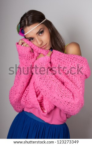 Gently girl posing with pink sweater - stock photo