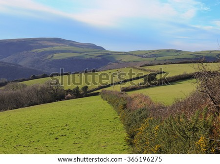 Gently Rolling Farmland around the Rural Village of Martinhoe within Exmoor National Park in Devon, England, UK - stock photo