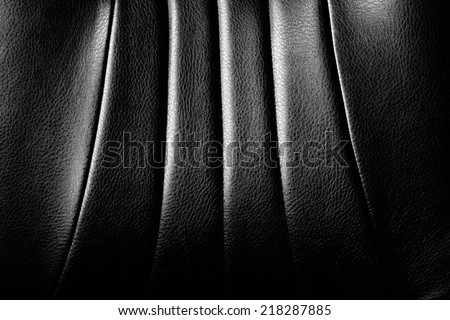 Genuine and elegance black leather texture detail. - stock photo