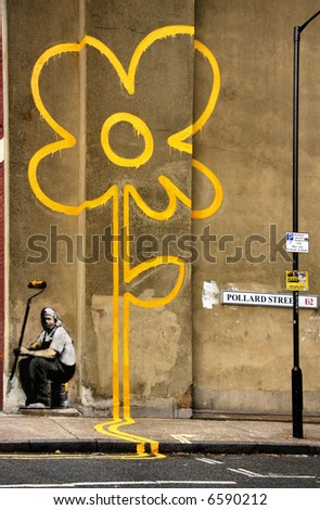 GENUINE BANKSY graffiti. Created 31st October 2007. Yellow Line Man. Pollard Street - stock photo