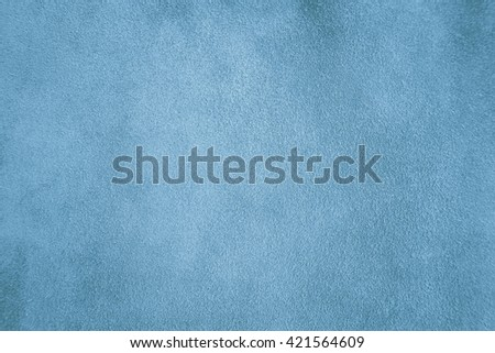 Genuine blue suede leather pad for background texture or another  - stock photo