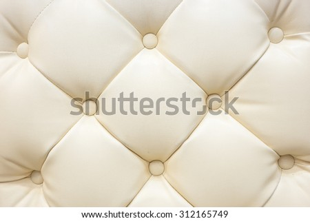 Genuine cream color of leather upholstery background for a luxury decoration  - stock photo