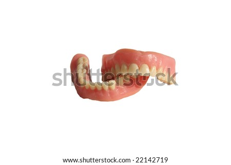 Genuine Dentures AKA False Teeth from a Dentist Office isolated on white - stock photo