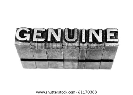 GENUINE in metallic letters on a white background - stock photo