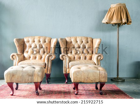 genuine leather classical style sofa in vintage room with desk lamp - stock photo
