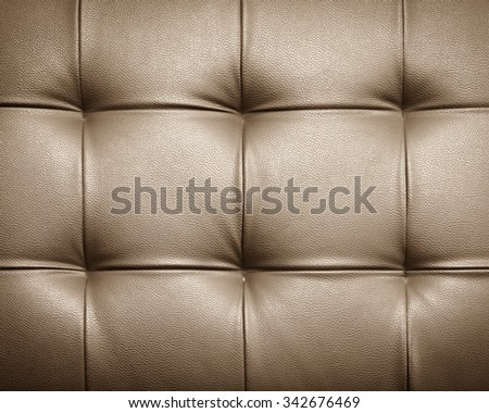 Genuine leather upholstery background for a luxury decoration in Brown tones - stock photo