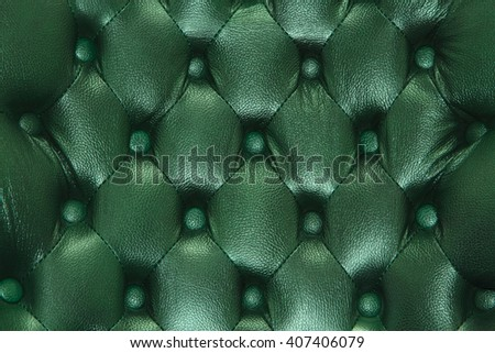 Genuine leather upholstery background for a luxury decoration in green tones - stock photo