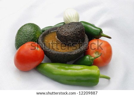 Genuine Mexican salsa generally is made in a lava stone mortar called a molcajete. Key ingredients are tomato, onion, garlic and hot pepper, chile - stock photo
