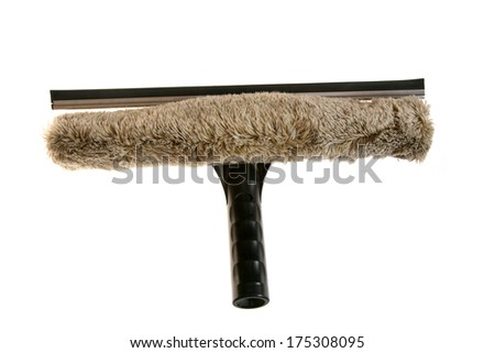 Genuine well used Window Washing Window Brush and Window Squeegee combination set isolated on white. Window Washers help keep your windows clean so you can enjoy the view from your home or building  - stock photo