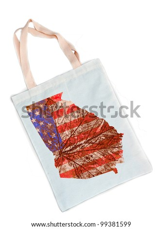 Geogia state of the United States of America in grunge flag pattern over white shopping bag isolated on white background - stock photo