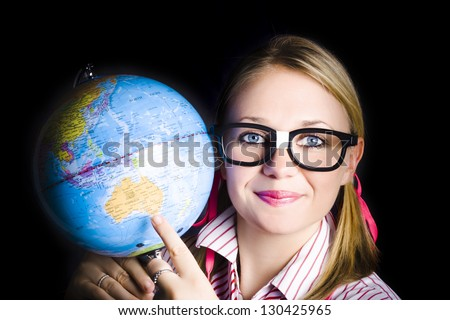 Geography student pointing to melbourne australia on a world globe when discovering places and regions on planet earth - stock photo
