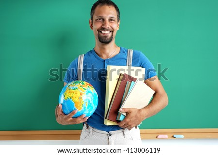 Geography teacher. Photo adult man with books and globe, creative concept with Back to school theme - stock photo