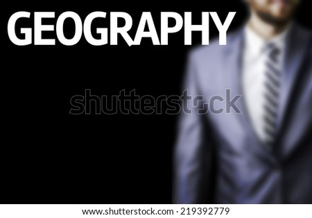 Geography written on a board with a business man on background - stock photo