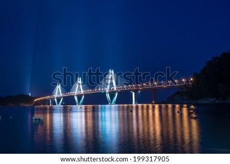 Geoje toll bridge from shore - stock photo