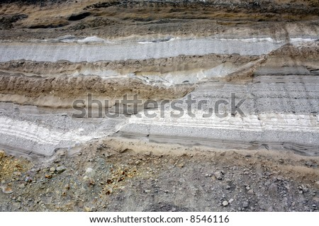 geological fault in strata of volcanic ash exposed in a road cutting - stock photo