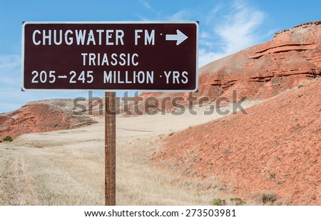 Geological Information Sign:  A road sign identifies the type and geological period of a rock formation in northeast Wyoming.  - stock photo