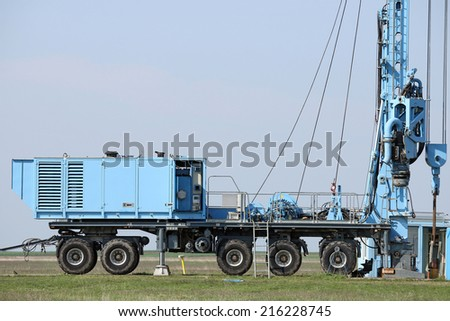 geology and oil exploration mobile drilling rig vehicle - stock photo