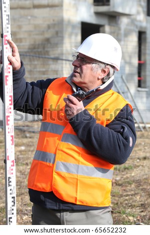 Geometer with a walkie-talkie - stock photo