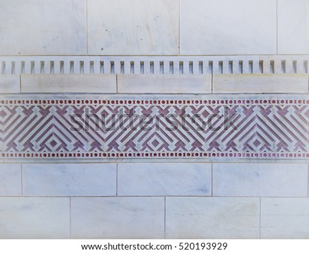 Geometric border carved in marble on the mosque building. Close up of wall.