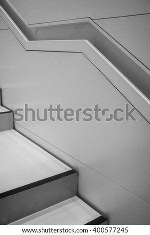 Geometric futuristic modern interior. Stairs and handrail.