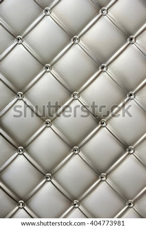 Geometric pattern embroidered on metallic fabric, background, texture, pattern - stock photo