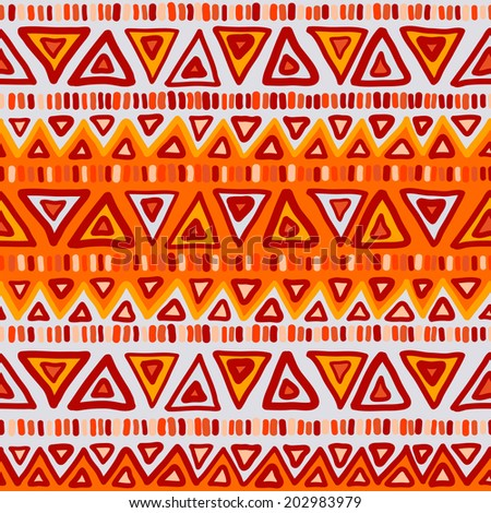 Geometric seamless pattern in ethnic style. Bright colorful shapes triangles, strips and zigzags.