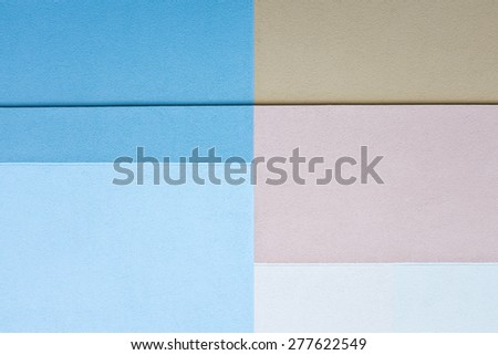 geometric shapes painted on textured cement wall - stock photo