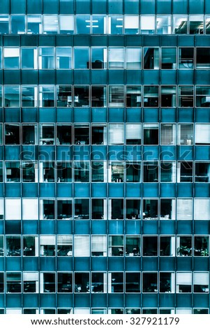 Geometric window facade on typical office building - stock photo