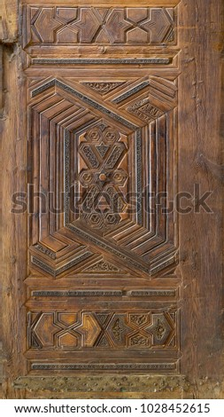 Geometrical and floral engraved patterns of Mamluk style wooden ornate door, Cairo, Egypt