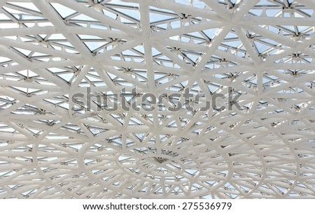 Geometrical glass roof in sunny day. Indoors view - stock photo