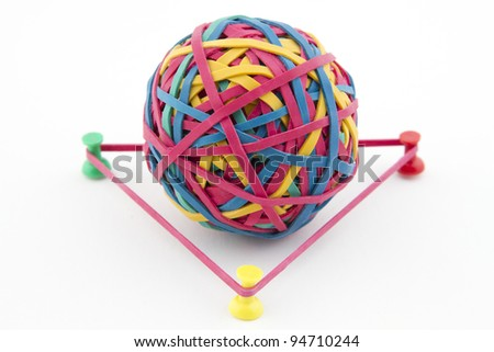 Geometry concept with a Rubber band ball - stock photo