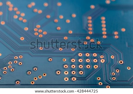 Geometry electronics, closeup of the blue circuit board, as a background, texture - stock photo