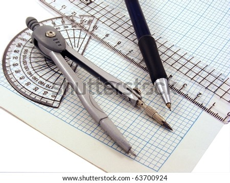 Geometry set with compass,pen,ruler & protractor on graph paper - stock photo