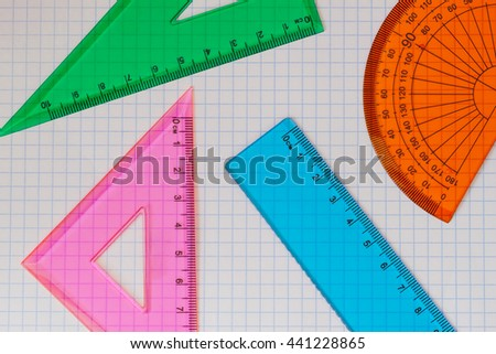Geometry set with triangles, rulers and protractor - stock photo