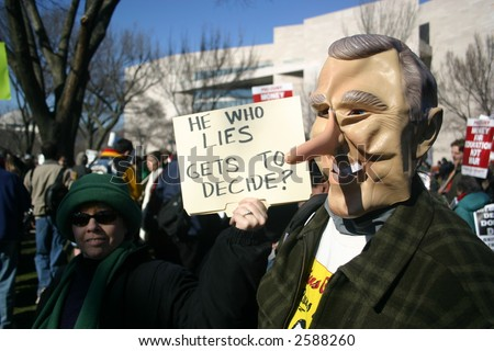 George Bush pinocchio costume at anti war rally on the National Mall, Washington, DC, Saturday, January 27, 2007. - stock photo