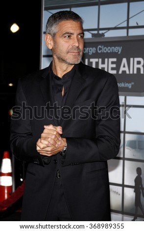 """George Clooney at the Los Angeles Premiere of """"Up In The Air"""" held at the Man Village Theater in Westwood, USA on November 30, 2009. - stock photo"""