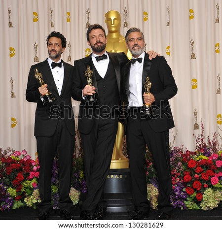 George Clooney, Grant Heslov & Ben Affleck at the 85th Academy Awards at the Dolby Theatre, Los Angeles. February 24, 2013  Los Angeles, CA Picture: Paul Smith - stock photo
