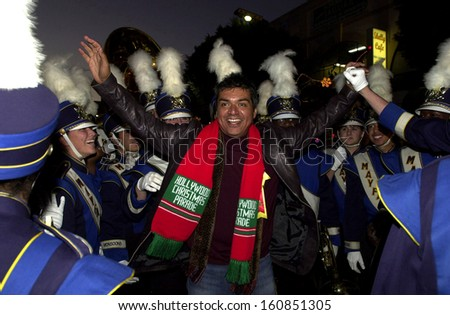 George Lopez with the Mayfair High School Monsoon Marching Corps during the 2004 Hollywood Christmas Parade, Los Angeles, CA, November 28, 2004 - stock photo
