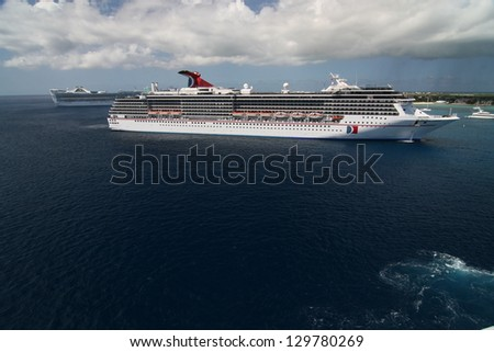 GEORGE TOWN, CAYMAN ISLANDS - APRIL 5: Cruise ship anchored at the harbor of Grand Cayman for this popular stop of cruise lines on April 5, 2008 in George Town, Cayman Islands. - stock photo