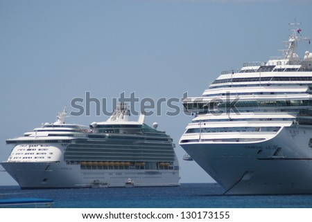 GEORGE TOWN, CAYMAN ISLANDS - APRIL 5: Cruise ships anchored at the harbor of Grand Cayman for this popular stop of cruise lines on April 5, 2008 in George Town, Cayman Islands. - stock photo