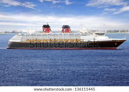 GEORGE TOWN, GRAND CAYMAN ISLAND - FEB 26: Disney Cruise Line, cruise ship Disney Magic Sails from Port George Town on February 26, 2013. - stock photo