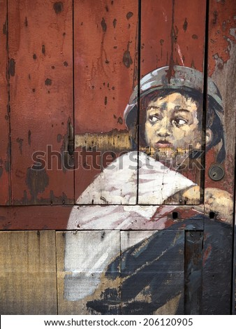 """George Town, Penang, Malaysia - April 25, 2014: Close-up of famous """"Boy on a Bike"""" mural, painted by Lithuanian artist Ernest Zacharevic in Georgetown, Penang, Malaysia. - stock photo"""