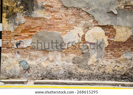 GEORGE TOWN,PENANG ,MALAYSIA- March 26, 2015: Public street art Little boy with pet dinosaur  on the wall by Lithuanian artist Ernest Zacharevic in Georgetown, Penang, Malaysia. - stock photo