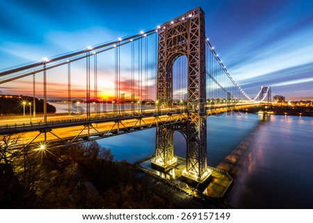 George Washington Bridge at sunrise in Fort Lee, NJ. George Washington Bridge is a suspension bridge spanning the Hudson River connecting NJ to Manhattan, NY. - stock photo
